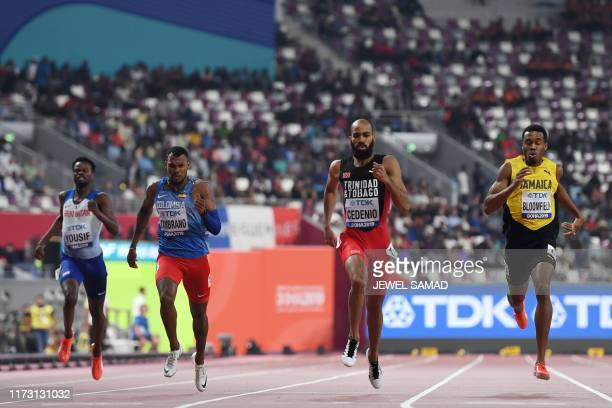 Britain's Rabah Yousif Colombia's Anthony Jose Zambrano Trinidad and Tobago's Machel Cedenio and Jamaica's Akeem Bloomfield compete in the Men's 400m...