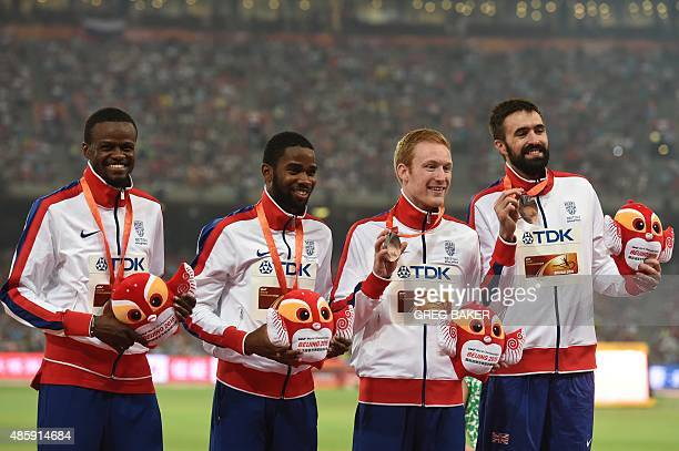 Britain's Rabah Yousif Delanno Williams Jarryd Dunn and Martyn Rooney celebrate during the victory ceremony for the men's 4x400 metres athletics...