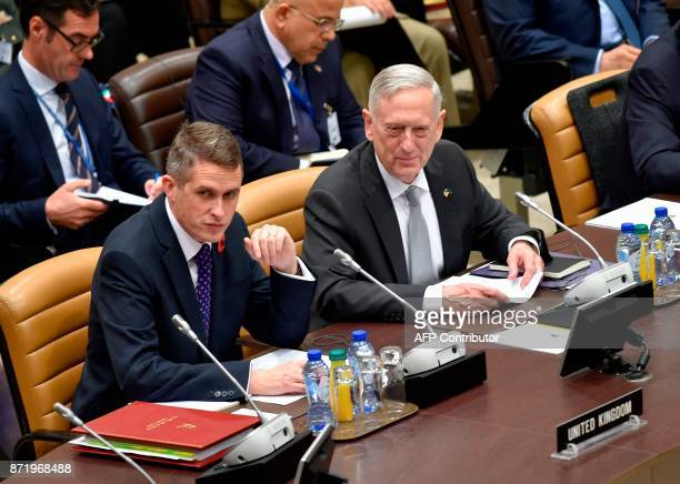 Britain's recently appointed Defence Minister Gavin Williamson and US Secretary of Defence James Mattis look on during the second day of a defence...