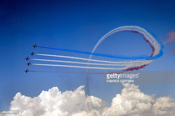 Britain's Red Arrows airplane display team performs during the second weekend of the AIR14 air show on September 6 2014 in Payerne western...