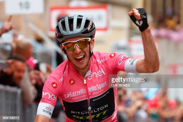Britain's rider of team Mitchelton-Scott Simon Yates celebrates after winning the 11th stage between Assisi and Osimo during the 101st Giro d'Italia,...