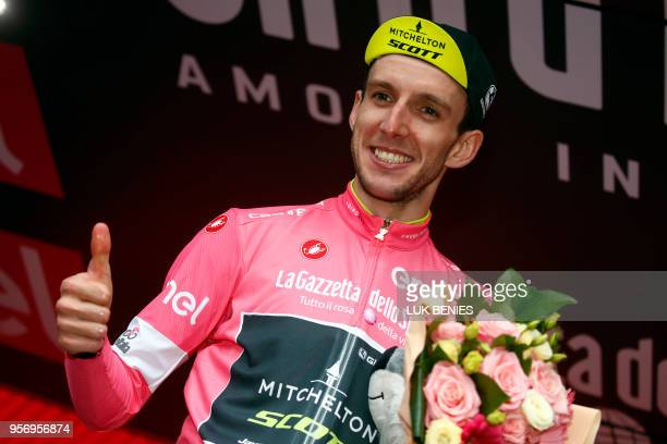 Britain's rider of team MitcheltonScott Simon Yates celebrates the pink jersey of the overall leader on the podium of the 6th stage between...