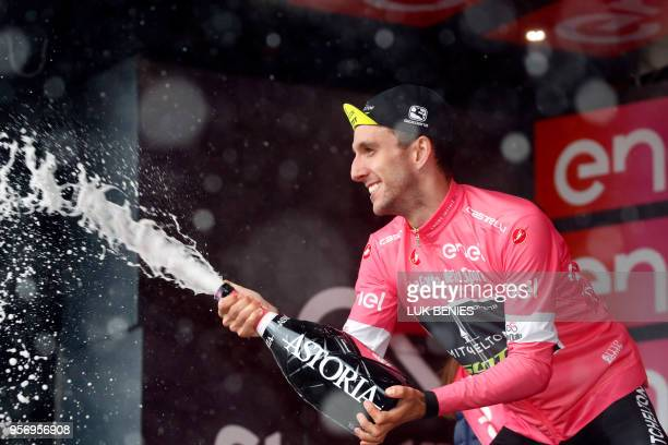 Britain's rider of team Mitchelton-Scott Simon Yates celebrates the pink jersey of the overall leader on the podium of the 6th stage between...