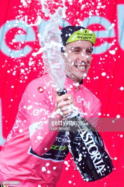 Britain's rider of team Mitchelton-Scott Simon Yates celebrates the pink jersey of the overall leader on the podium after winning the 15th stage...