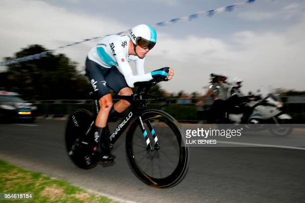 Britain's rider of team Sky Chris Froome rides during the 1st stage of the 101st Giro d'Italia Tour of Italy on May 4 a 97 kilometers individual...