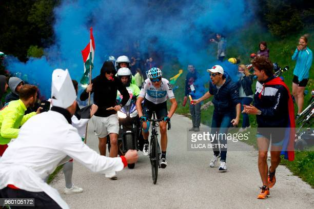 Britain's rider of team Sky Christopher Froome climbs the Monte Zoncolan as cycling fans cheer along the road during the 14th stage between San Vito...