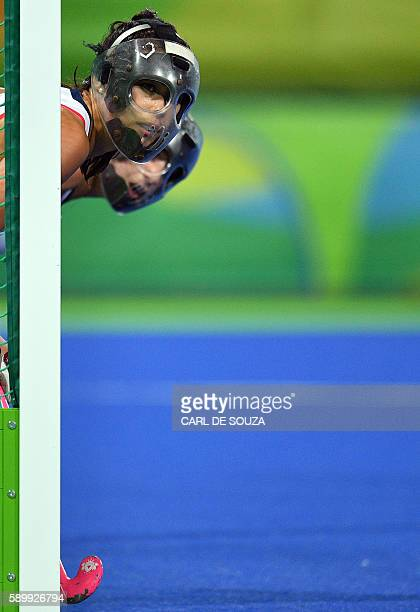 TOPSHOT Britain's Sam Quek defends her team's goal during the women's quarterfinal field hockey Britain vs Spain match of the Rio 2016 Olympics Games...