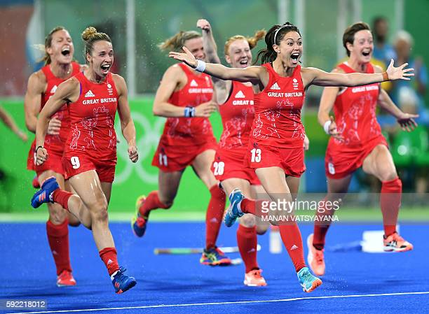 Britain's Sam Quek leads teammates as they run celebrating their victory at the end of the women's Gold medal hockey Netherlands vs Britain match of...