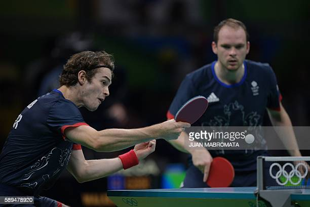 Britain's Samuel Walker and Britain's Paul Drinkhall play against China's Xu Xin and China's Zhang Jike in their men's team quarter-final table...