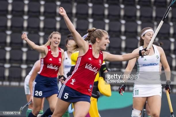 Britain's Sarah Evans celebrates after scoring next to Ireland's Megan Frazer during the match between Ireland and England, at the European Hockey...