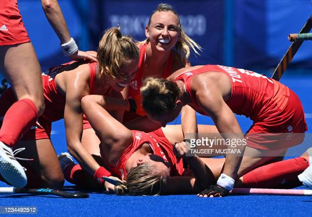 Britain's Sarah Robertson celebrates with teammates after scoring against India during the women's bronze medal match of the Tokyo 2020 Olympic Games...