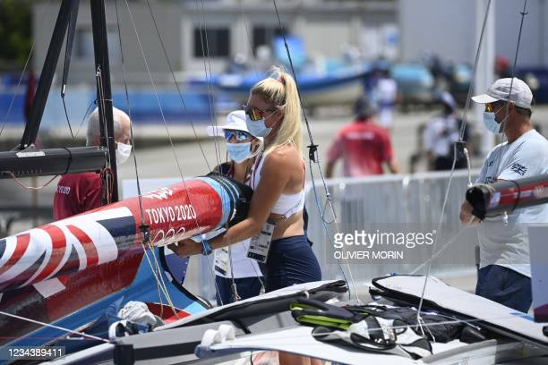 Britain's Saskia Tidey folds a sail before the women's skiff 49er FX race during the Tokyo 2020 Olympic Games sailing competition at the Enoshima...