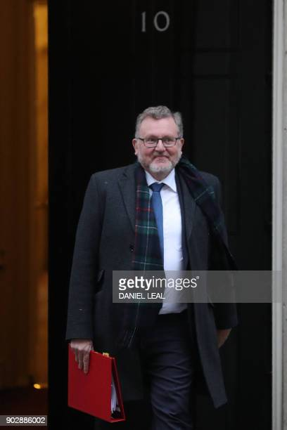 Britain's Scotland Secretary David Mundell leaves 10 Downing street in central London after the first cabinet meeting of the new year following a...