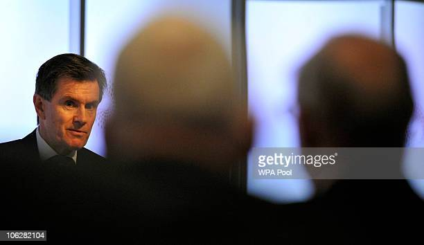 Britain's Secret Intelligence Service Chief Sir John Sawers addresses a live televised gathering of academics officials and editors on October 28...