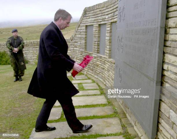 Britain's Secretary Of State for Defence Geoff Hoon lays a wreath at the cemetry at San Carlos on the Falklands Islands for British Soldiers who lost...