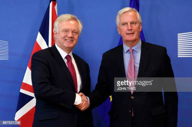 Britain's Secretary of State for Exiting the European Union David Davis and European Union's French chief Brexit negotiator Michel Barnier shake...