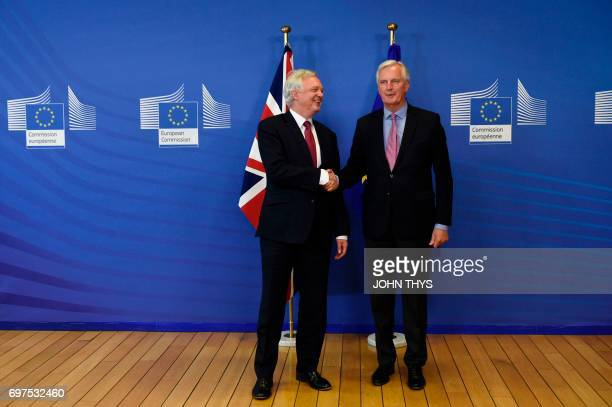 Britain's Secretary of State for Exiting the European Union David Davis and European Commission member in charge of Brexit negotiations with Britain...