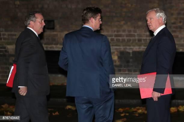 Britain's Secretary of State for Exiting the European Union David Davis and Britain's International Trade Secretary Liam Fox talk with Britain's...