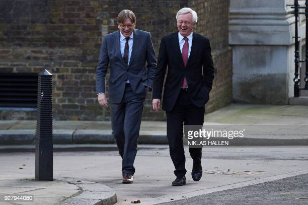 Britain's Secretary of State for Exiting the European Union David Davis reacts as he talks with the European Parliament's Brexit coordinator Guy...