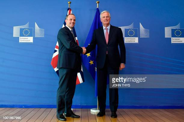 Britain's Secretary of State for Exiting the European Union Dominic Raab and EU Chief Brexit Negotiator Michel Barnier shake hands during their...