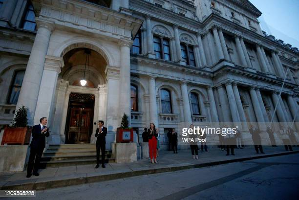 Britain's Secretary of State for Foreign Affairs Dominic Raab and Britain's Chancellor of the Exchequer Rishi Sunak and staff applaud during the Clap...