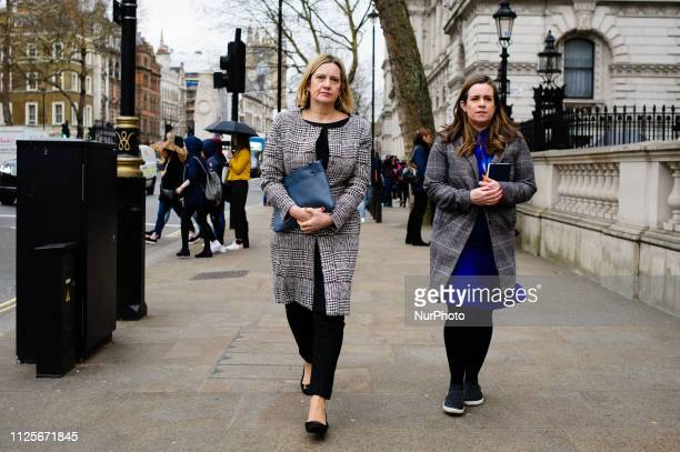 Britain's Secretary of State for Work and Pensions Amber Rudd walks with a colleague along Whitehall in London England on February 18 2019 Efforts to...