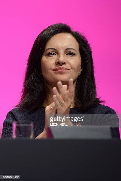 Britain's Shadow Secretary for Energy and Climate Change Caroline Flint applauds in the main hall of Manchester Central in Manchester on September 23...