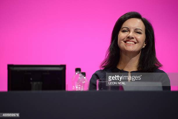 Britain's Shadow Secretary for Energy and Climate Change Caroline Flint addresses delegates in the main hall of Manchester Central in Manchester on...