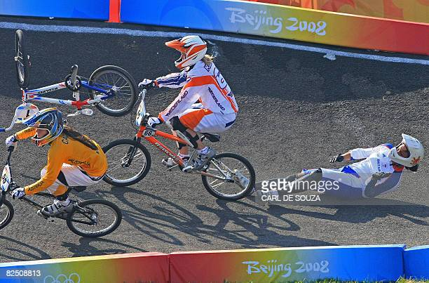 Britain's Shanaze Reade falls while Nicole Callisto of Australia and Lieke Klaus of the Netherlands race past during the semi-final heat in the...