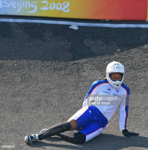 Britain's Shanaze Reade grimaces in pain after falling from her bike during a semi-final heat in the women's BMX finals at the 2008 Beijing Olympic...