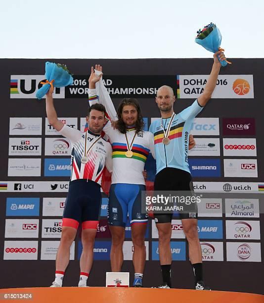 Britain's silver medallist Mark Cavendish, Slovakia's gold medallist Peter Sagan and Belgium's bronze medallist Tom Boonen celebrate on the podium at...