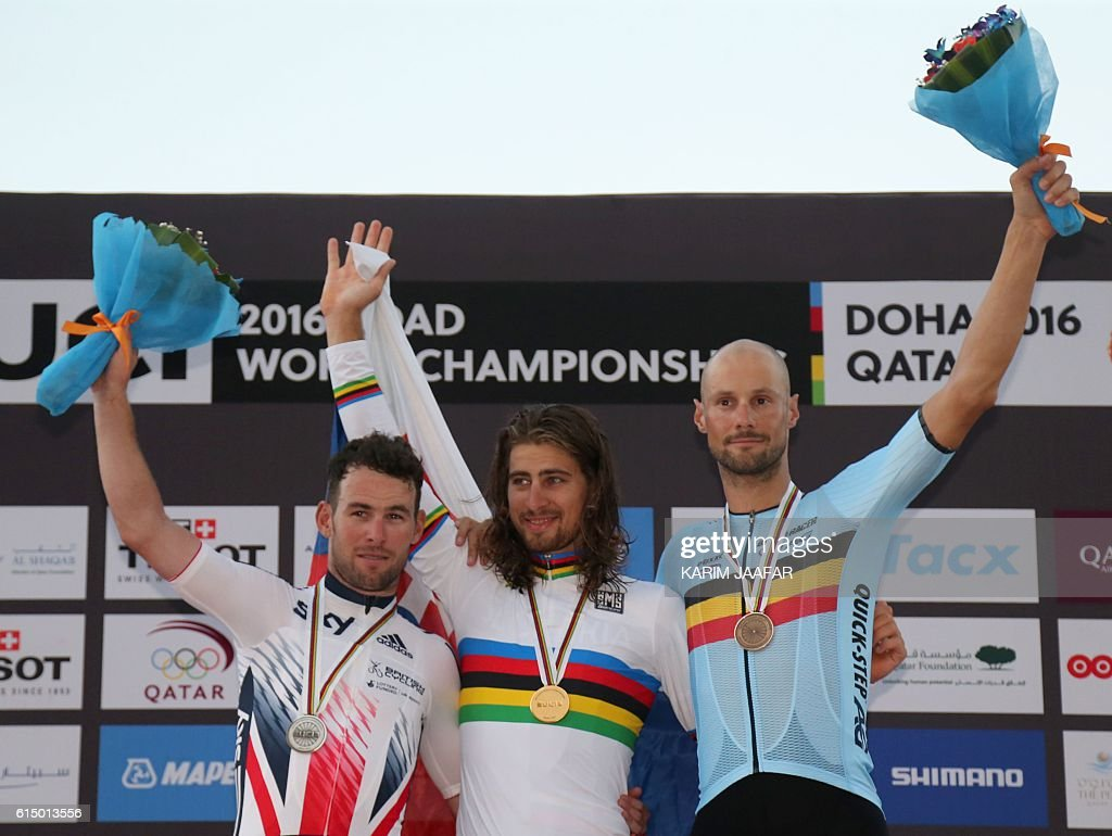 Britain's silver medallist Mark Cavendish, Slovakia's gold medallist Peter Sagan and Belgium's bronze medallist Tom Boonen celebrate on the podium at the end of the men's elite road race event as part of the 2016 UCI Road World Championships on October 16, 2016, in the Qatari capital Doha. / AFP / KARIM