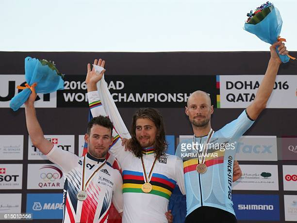 Britain's silver medallist Mark Cavendish Slovakia's gold medallist Peter Sagan and Belgium's bronze medallist Tom Boonen celebrate on the podium at...