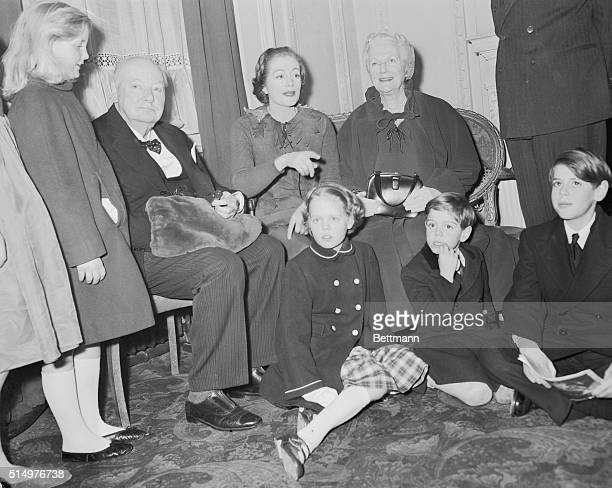 Britain's Sir Winston and lady Churchill are shown with members of thier family at the Scala Theatre where they saw their daughter actress Sarah...