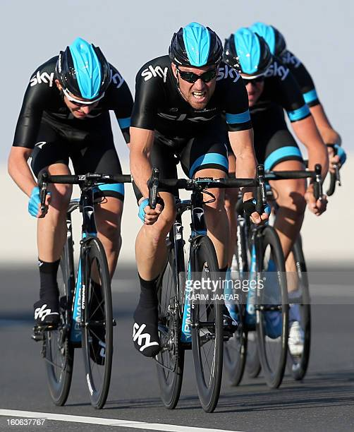 Britain's Sky team's cyclists ride their bikes during the second stage of the 2013 cycling Tour of Qatar a 14kilometre team timetrial in the Qatari...