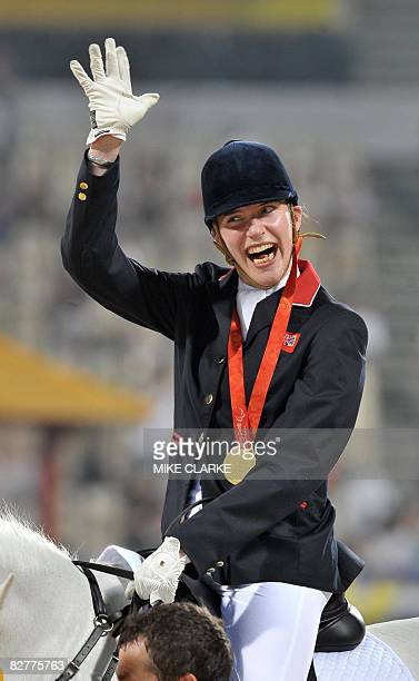 Britain's Sophie Christiansen waves after the Individual Freestyle Test Grade Ia medal ceremony during the 2008 Beijing Paralympic Games Equestrian...