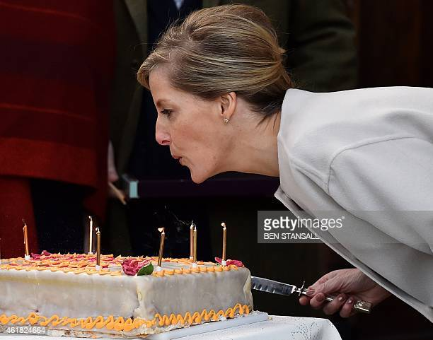 Britain's Sophie Countess of Wessex blows out the candles on a cake to celebrate her 50th birthday presented to her during a visit to Tomorrow's...