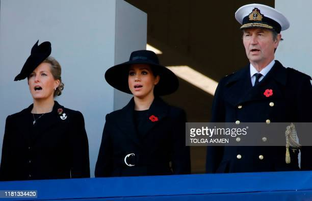Britain's Sophie Countess of Wessex Britain's Meghan Duchess of Sussex and Vice Admiral Timothy Laurence attend the Remembrance Sunday ceremony at...