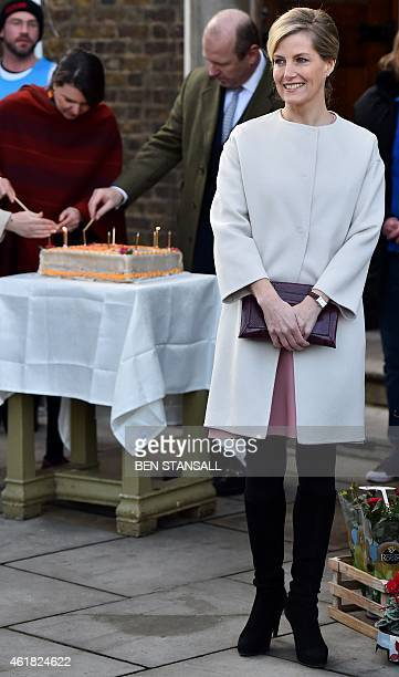Britain's Sophie Countess of Wessex poses for photographers as candles are lit on a cake to celebrate her 50th birthday during a visit to Tomorrow's...
