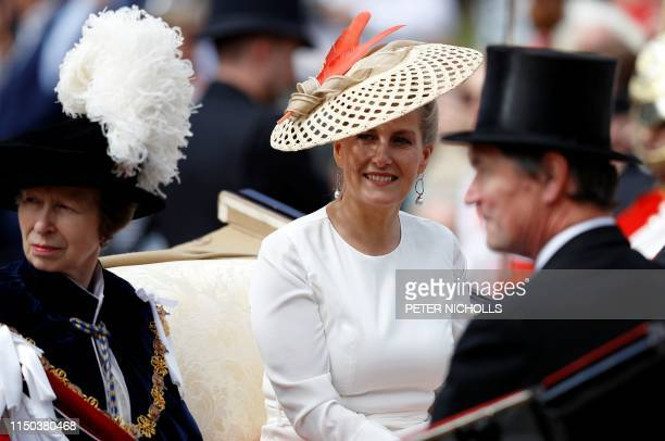 Britain's Sophie Countess of Wessex rides with Britain's Princess Anne Princess Royal as they leave following the Order of the Garter Service at St...