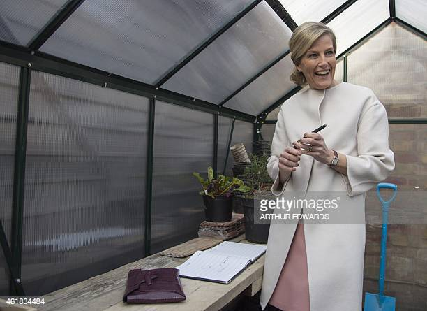 Britain's Sophie Countess of Wessex signs a book in a greenhouse during a visit to Tomorrow's People Social Enterprises St Anselm's Church in London...