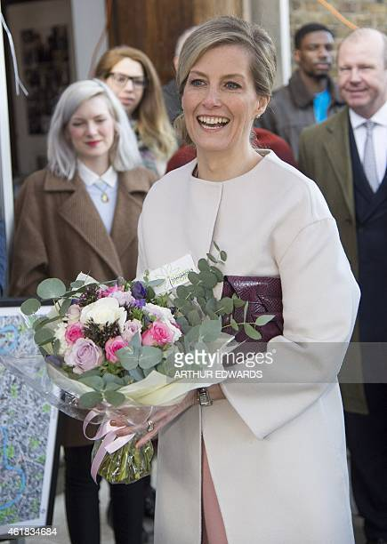 Britain's Sophie Countess of Wessex smiles after recieving a bunch of flowers during a visit to Tomorrow's People Social Enterprises St Anselm's...