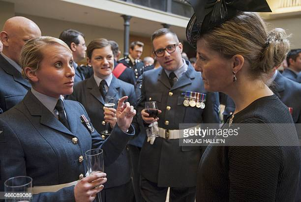 Britain's Sophie Countess of Wessex speaks with military personnel during a reception at the Honourable Artillery Company in London on March 13...