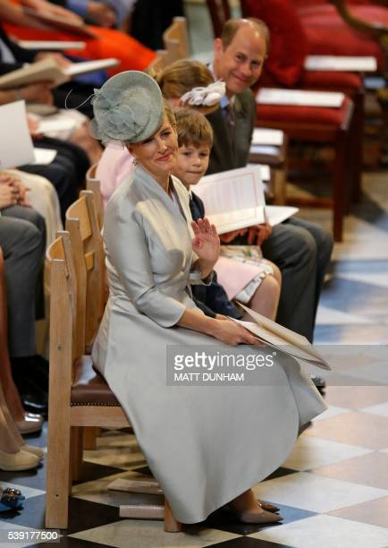 Britain's Sophie Countess of Wessex waves after arriving to attend a national service of thanksgiving for the 90th birthday of Britain's Queen...
