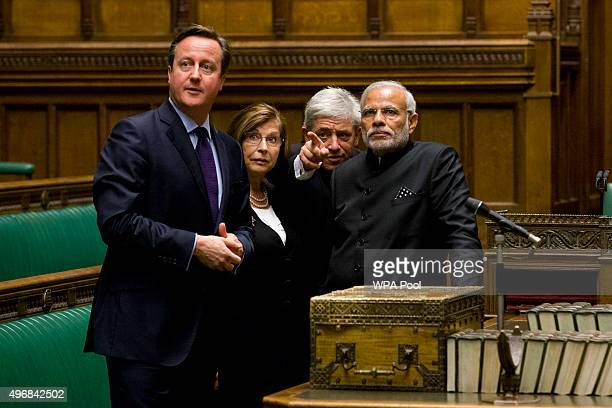 Britain's Speaker of the House of Commons John Bercow gestures standing behind the dispatch box as he British Prime Minister David Cameron and...