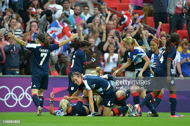 Britain's Stephanie Houghton celebrates with teammates after scoring the opening goal against Brazil in the women's football match at Wembley Stadium...