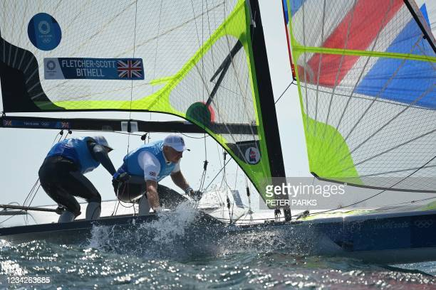 Britain's Stuart Bithell and Dylan Fletcher-Scott compete in the men's skiff 49er race during the Tokyo 2020 Olympic Games sailing competition at the...