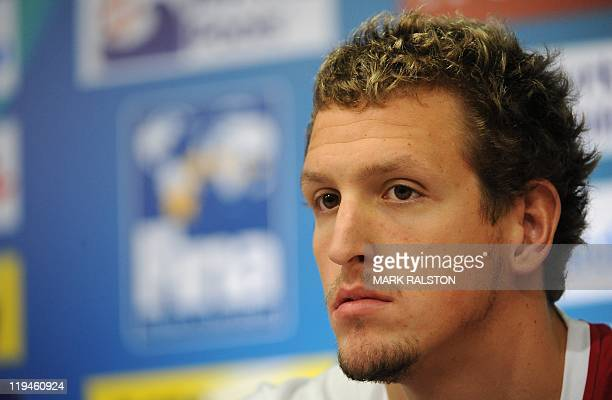 Britain's swimmer Adam Brown looks on during a press conference held by Britain's swimming team at the indoor stadium of the Oriental Sports Center...