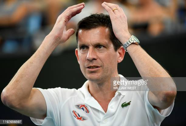 Britain's team captain Tim Henman reacts as he watches his team take on Australia at the ATP Cup tennis tournament in Sydney on January 9 2020 /...