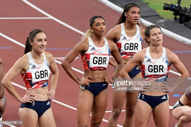 Britain's team react after the women's 4x400m relay heats during the Tokyo 2020 Olympic Games at the Olympic Stadium in Tokyo on August 5, 2021.